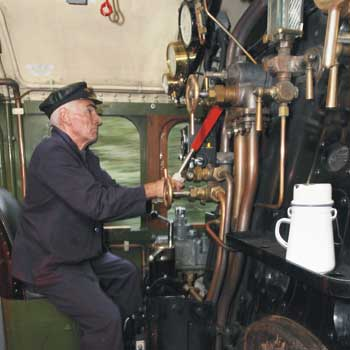 At the controls of a steam train Leicestershire